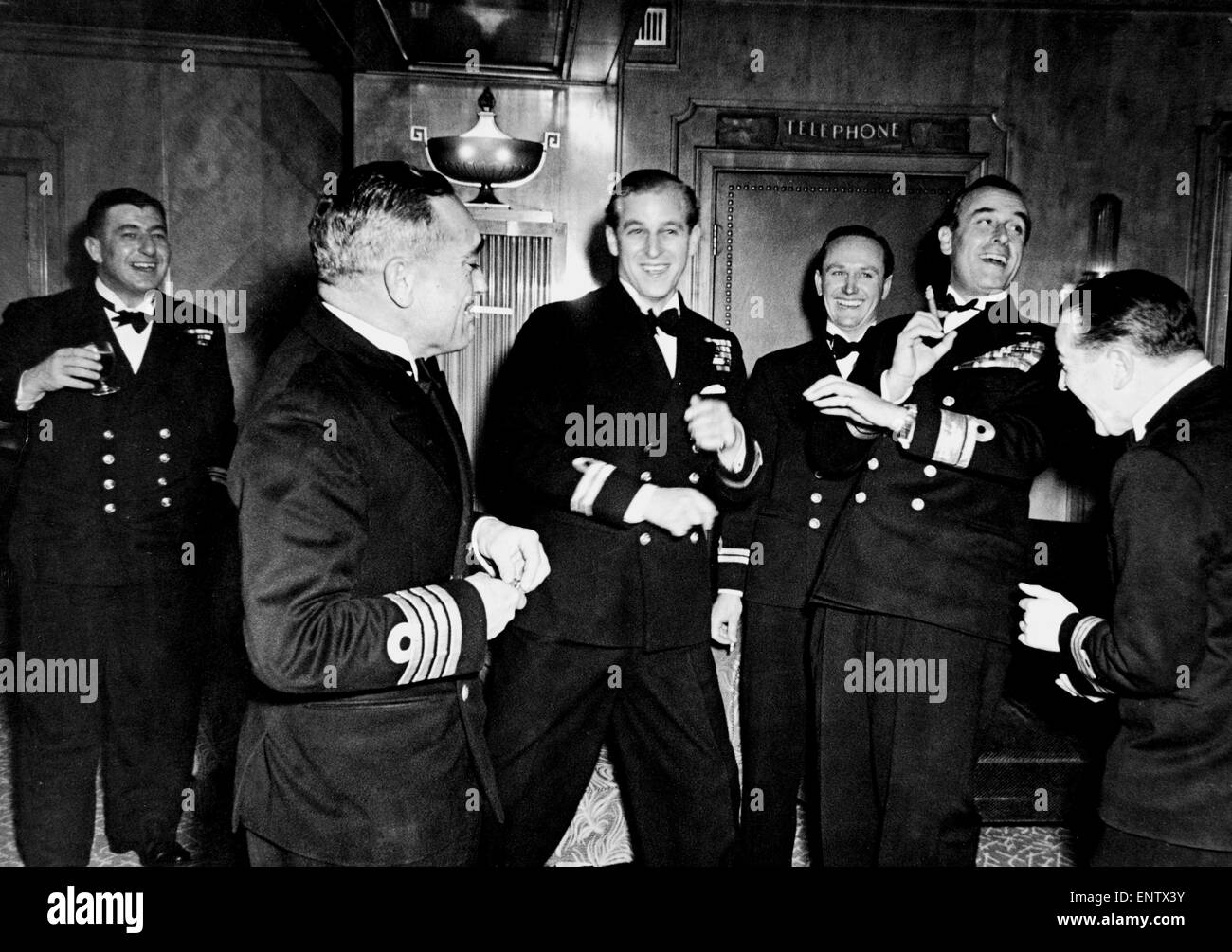 Philip Mountbatten the night before his wedding to the Queen with Naval friends and his uncle. 20th November 1947. - Stock Image