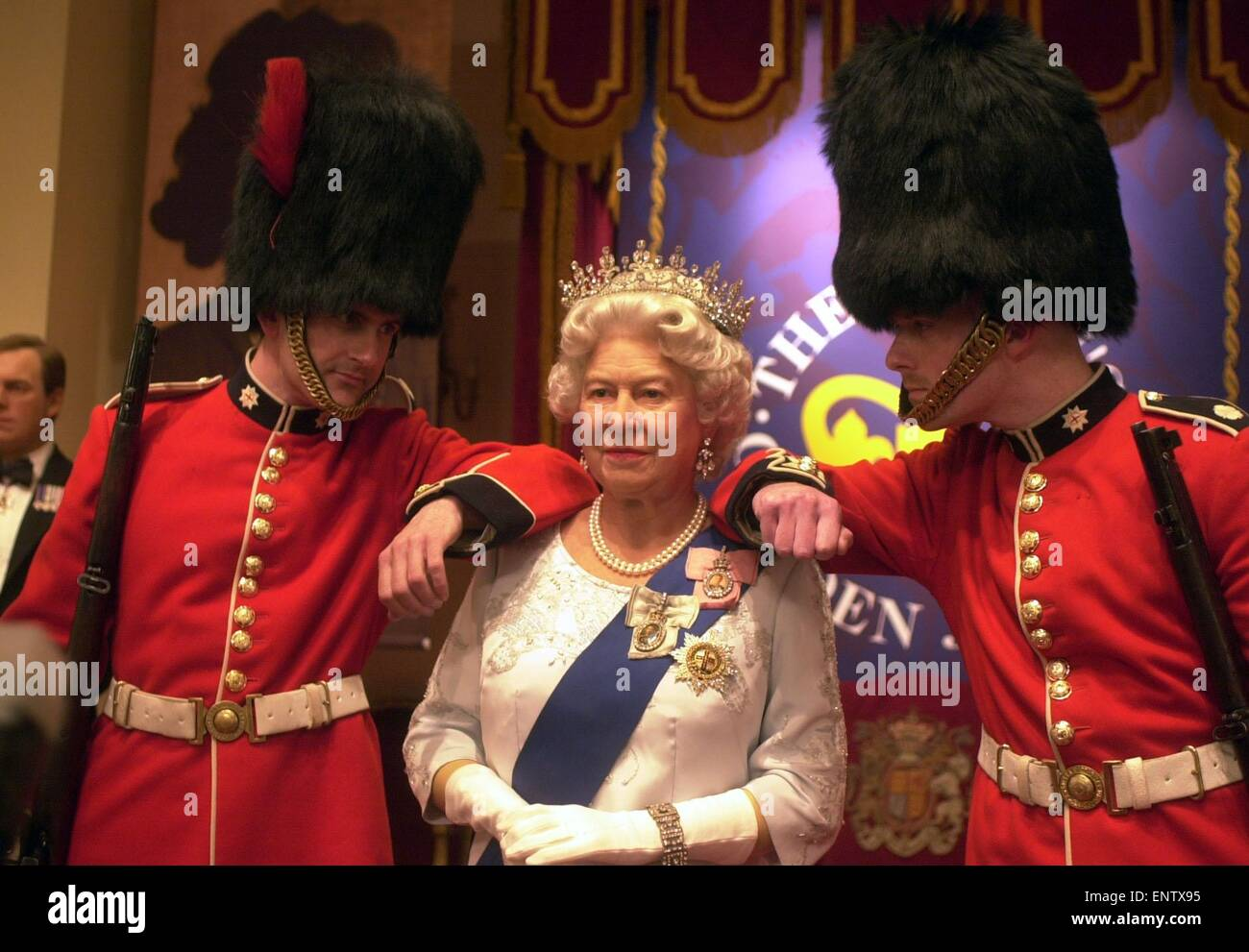 Visitors at Madame Tussauds Wax Works can have their pictures taken with the Queen Elizabeth II model, the ropes - Stock Image