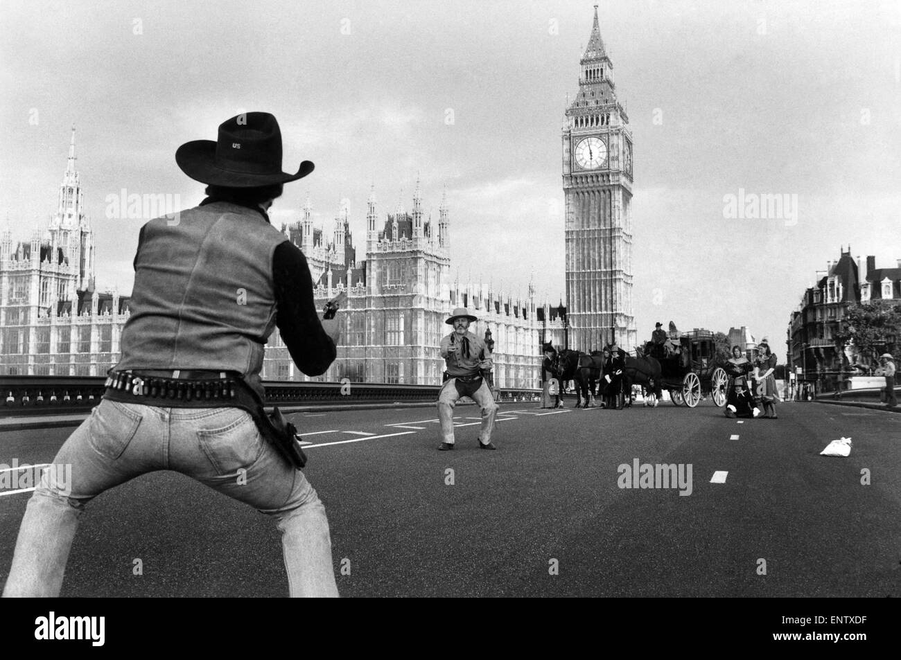 High Dawn in the West (Minster): This shoot took place on WestMinster Bridgre this morning at Dawn. dozen cowboys - Stock Image