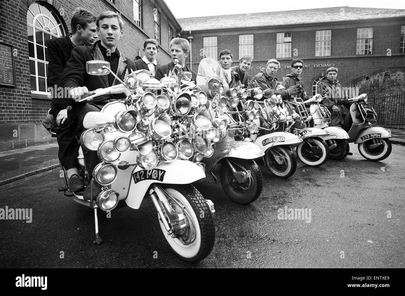 Mods in Peckham, South London, May 1964. Including John Rogers, with his scooter, sporting 43 chrome extras. - Stock Image