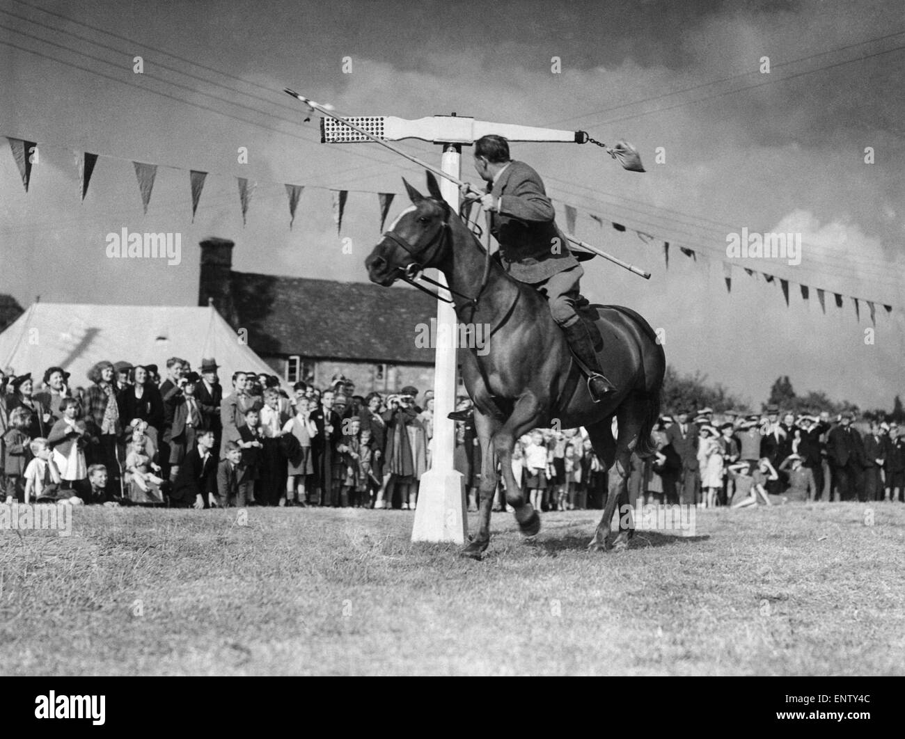 The old sport of tilting at the quintain, one popular throughout medieval England, was revived at Offham, Maidstone, - Stock Image