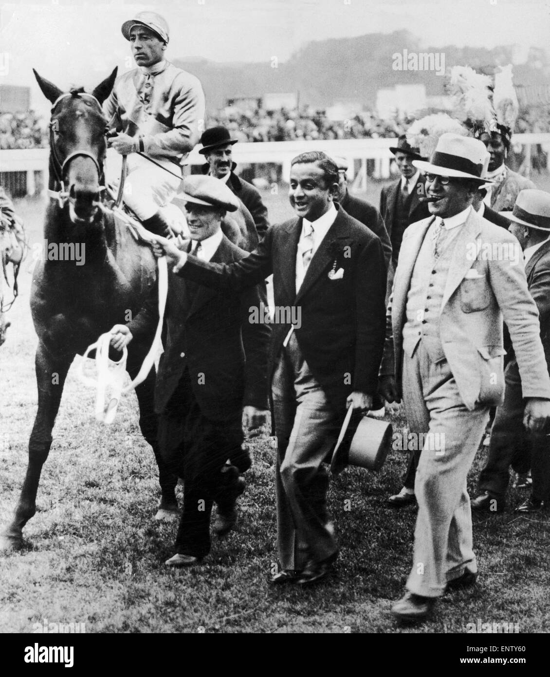 Windsor Lad ridden by Charlie Smirke being led in by the Maharajah of Rajpipla after winning the 1934 Derby 6th - Stock Image