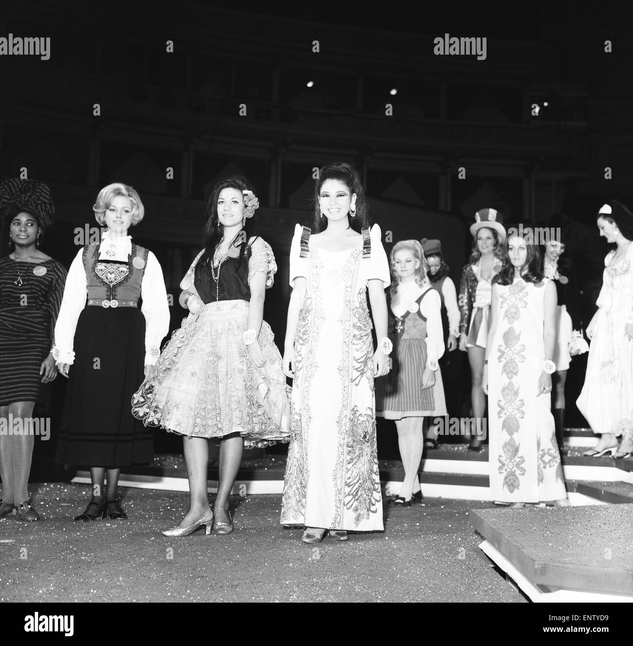 Miss World Contestants in traditional dress, at the Royal Albert Hall, 27th November 1969. Pictured: Front row L Stock Photo