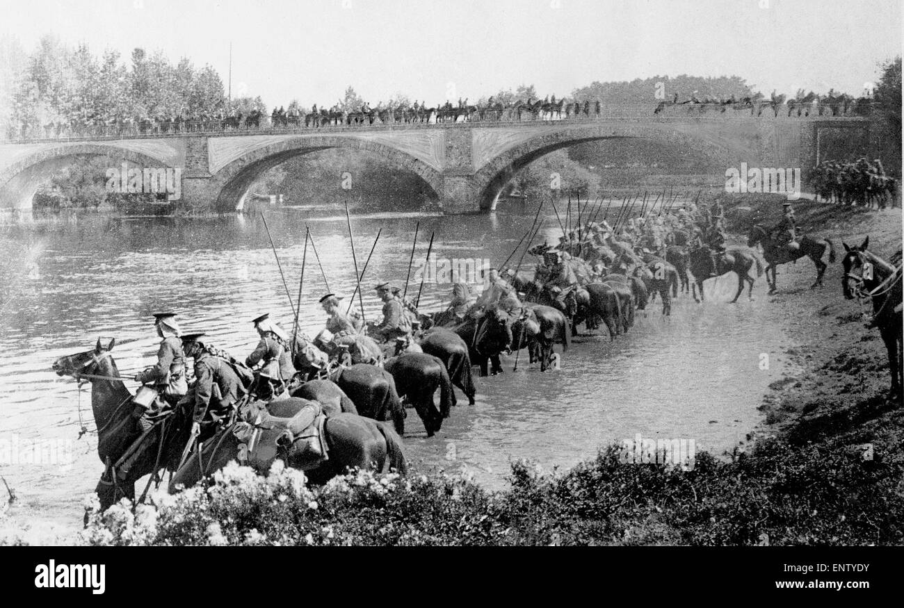 British cavalry watering their horses at a river in France. Circa October 1914 Original Caption: Lancers watering - Stock Image
