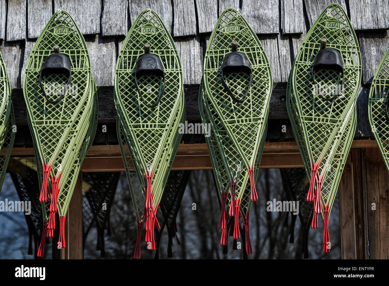 Snowshoes hanging outside - Stock Image