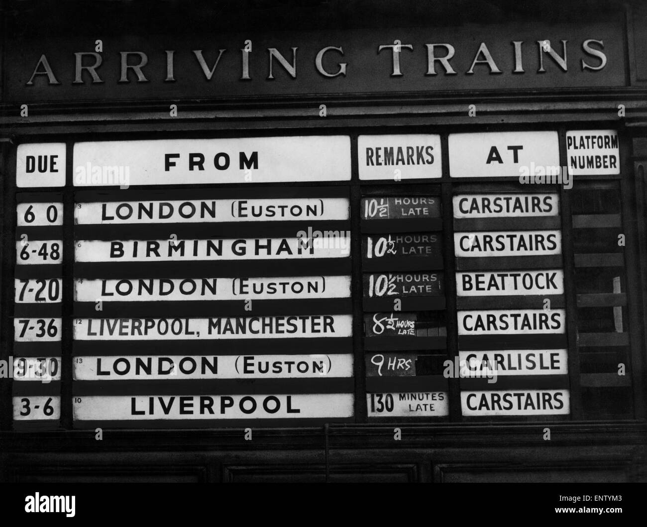 Arrivals Board indicates severe train delays at Glasgow Central Station, Glasgow, Scotland, 25th February 1958. - Stock Image
