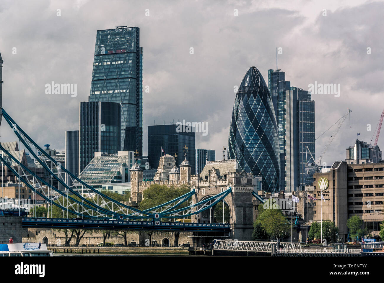 The Gherkin, cheesegrater and Heron Tower viewed from south side of river Thames at Tower Bridge - Stock Image