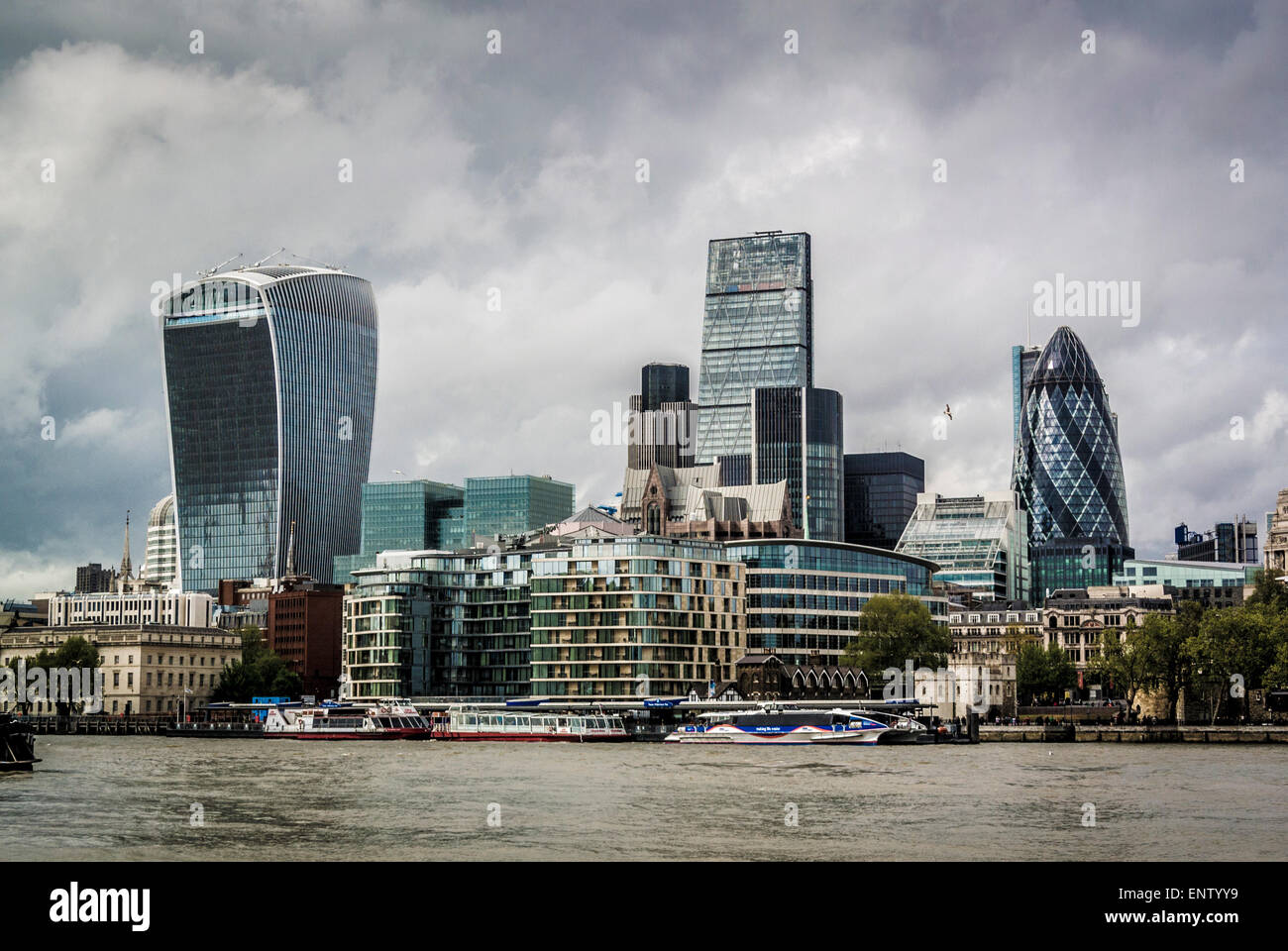 The Gherkin, cheesegrater and Walkie-Talkie building viewed from south side of river Thames at Tower Bridge - Stock Image