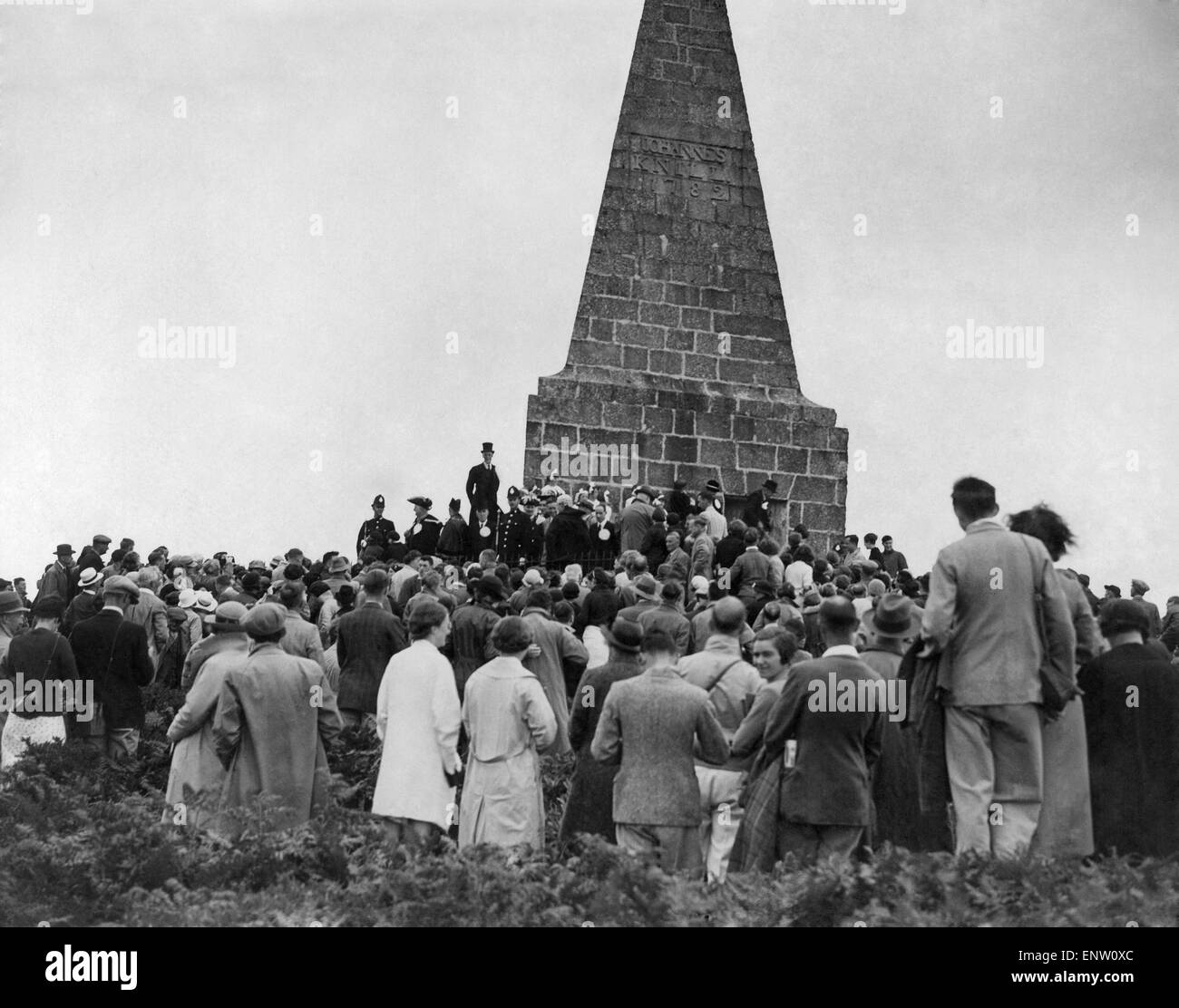 A crowd of people from nearby St Ives gather around the monument to John Knill former Mayor of St Ives. The monument - Stock Image