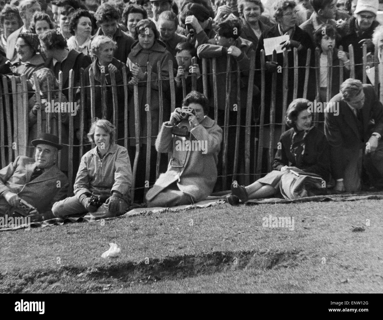 Her Majesty Queen Elizabeth II taking a picture at the Badminton Horse Trials. 13th April 1962 - Stock Image