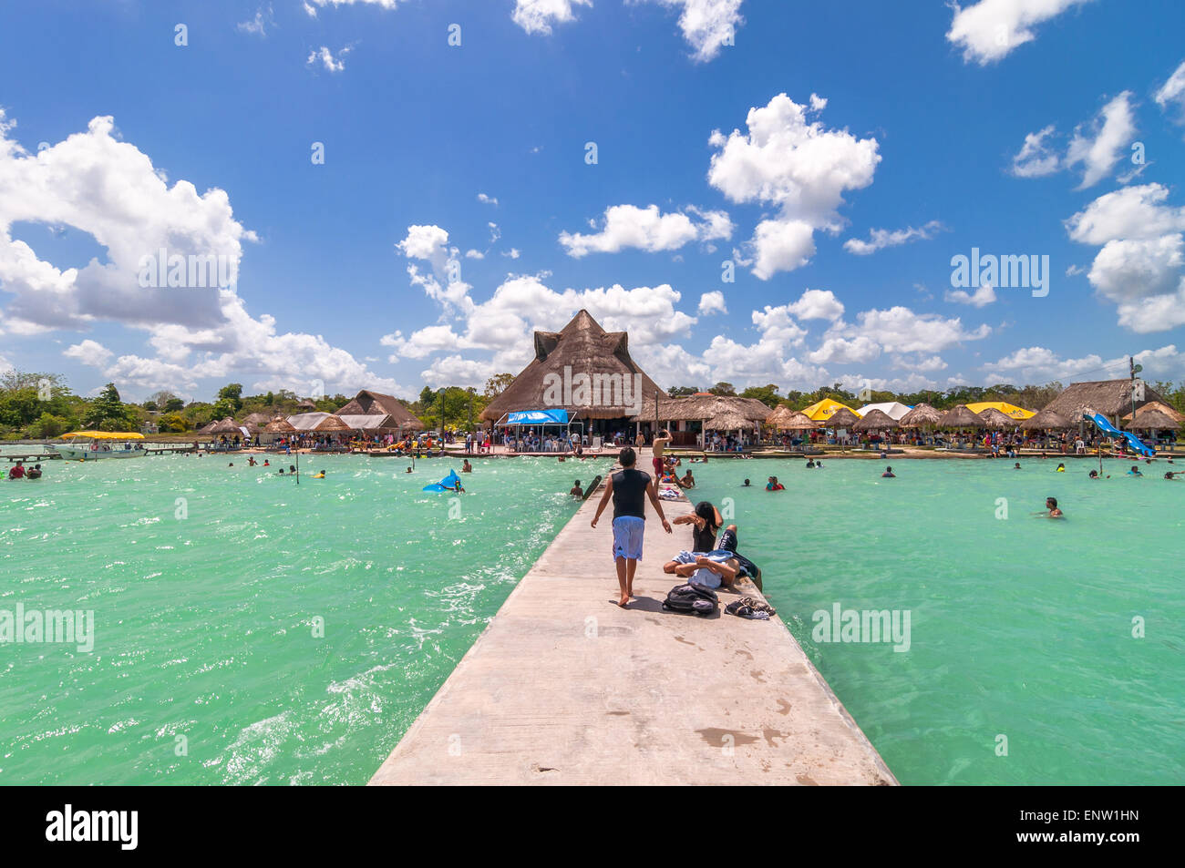 Bacalar, Mexico - April 26, 2014: locals and tourists enjoy turquoise water at Balneario magico in Bacalar lagoon, - Stock Image
