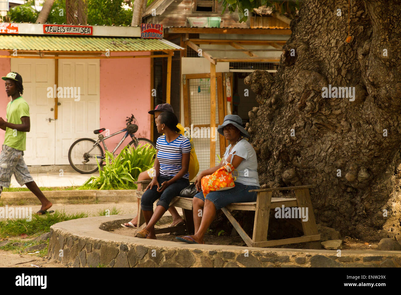 Islanders waiting for transport in a town square on island of St Vincent West Indies - Stock Image