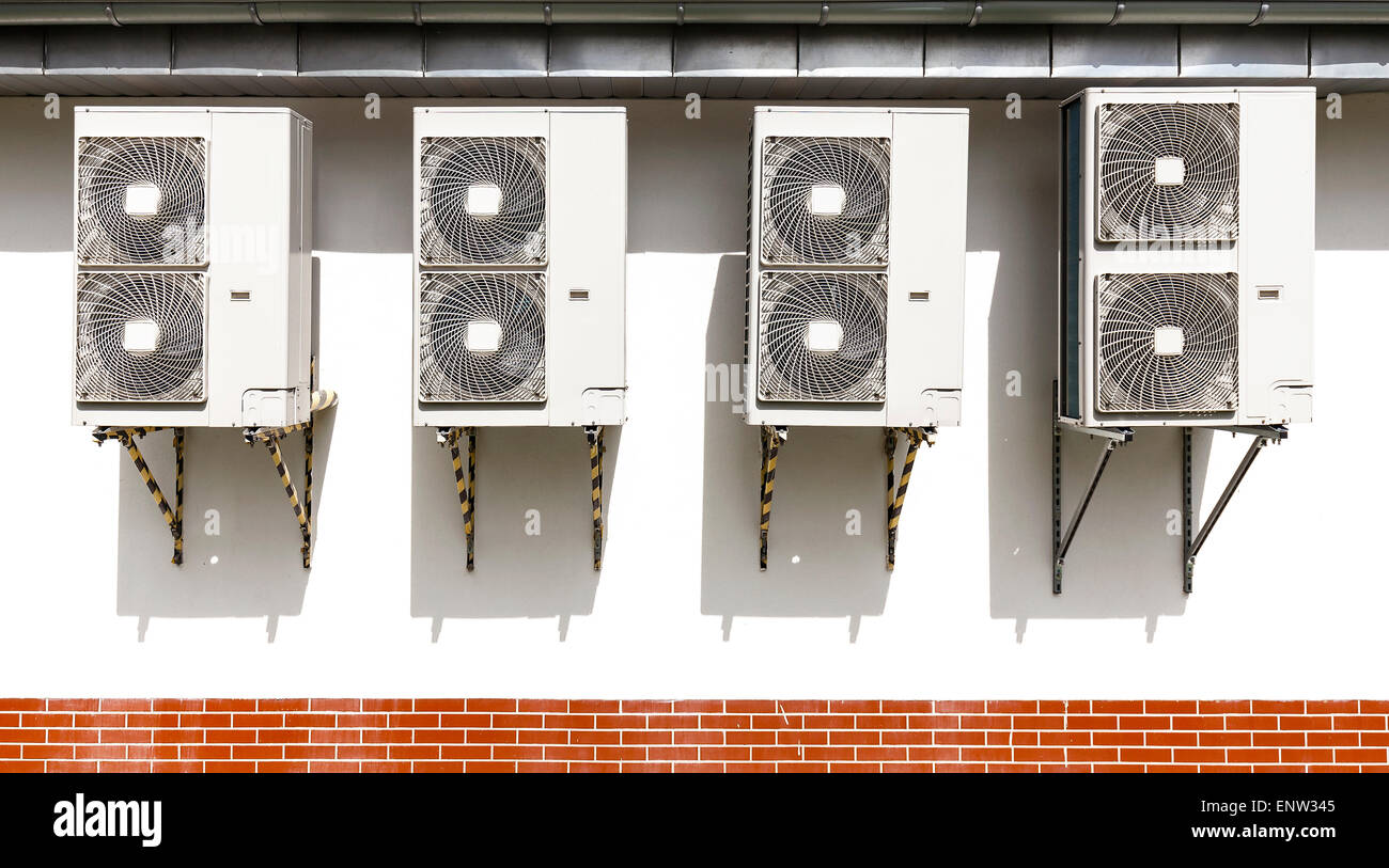 Air conditioning system assembled on a wall of a building. - Stock Image