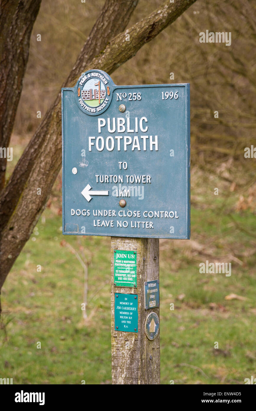 Sign signalling a public footpath to Turton Tower in Bolton - Stock Image