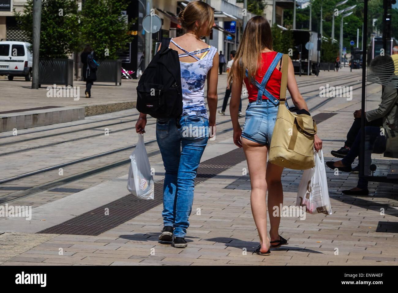 Tours, France, Two women walking along a street, one wearing revealing hot pants. Stock Photo