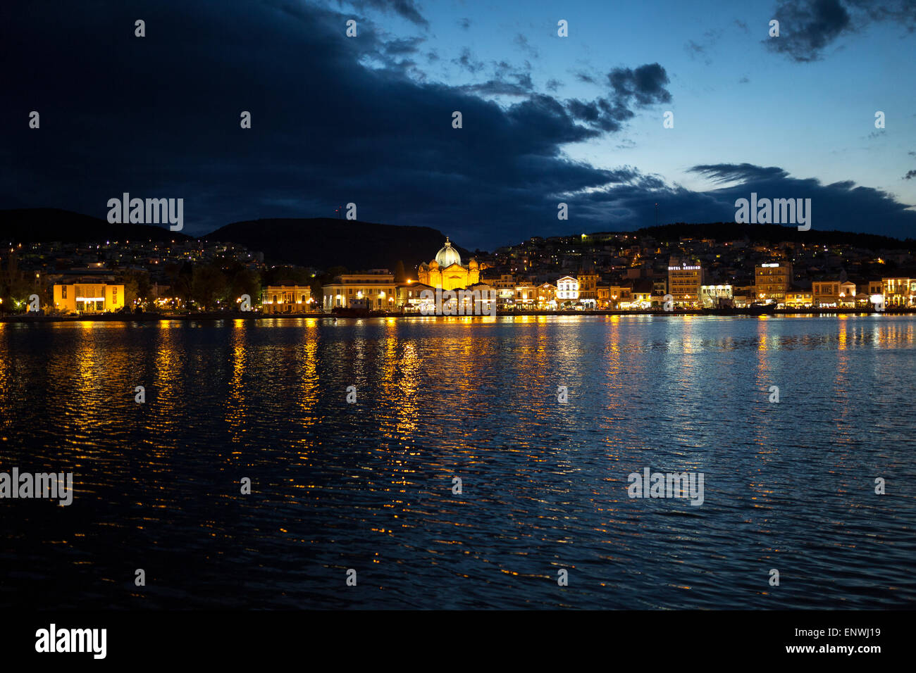 The port of Mitilene during the sunset. It is distinguished the church of Saint Therapist. Lesvos island, Greece. - Stock Image