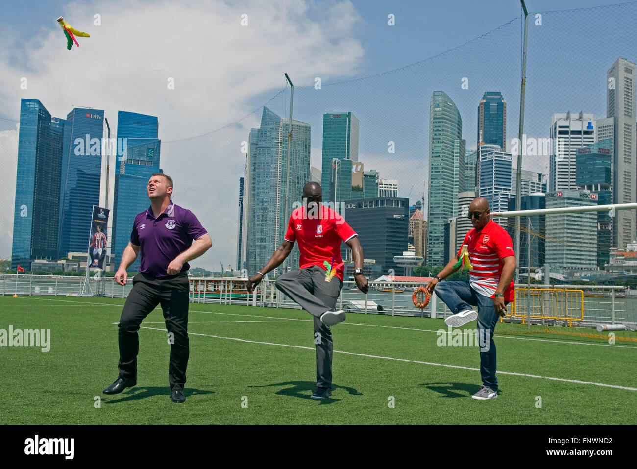 Singapore, Singapore. 12th May, 2015. Former Barclays Premier League (BPL) Arsenal player Ian Wright (R), former Stock Photo