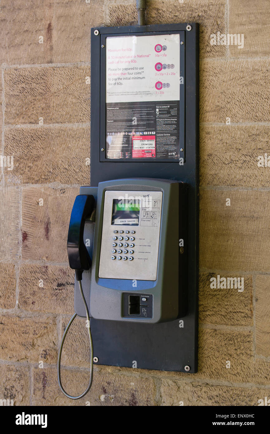 Wall hanging payphone at train station - Stock Image