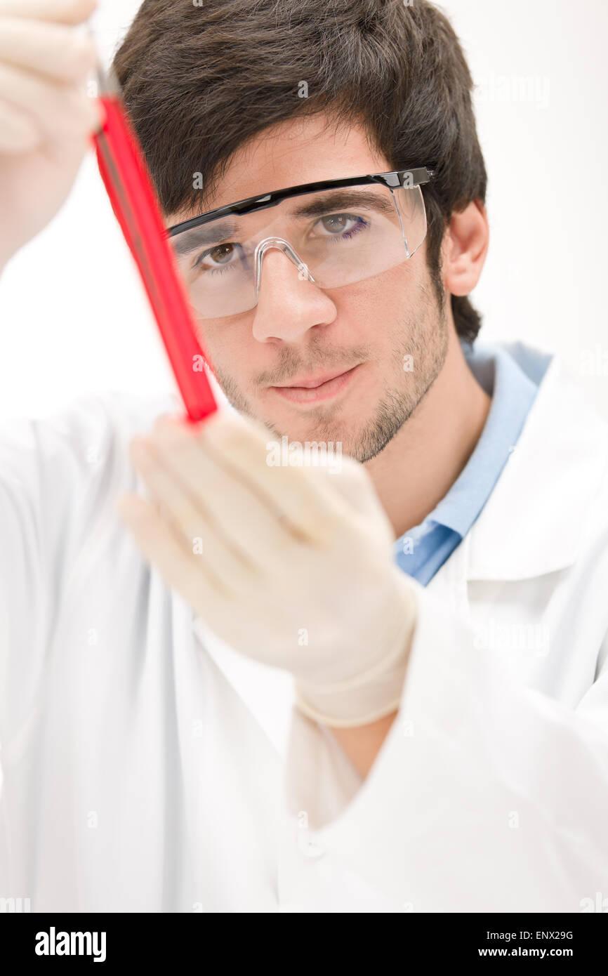 Flu virus experiment -  scientist in laboratory - Stock Image