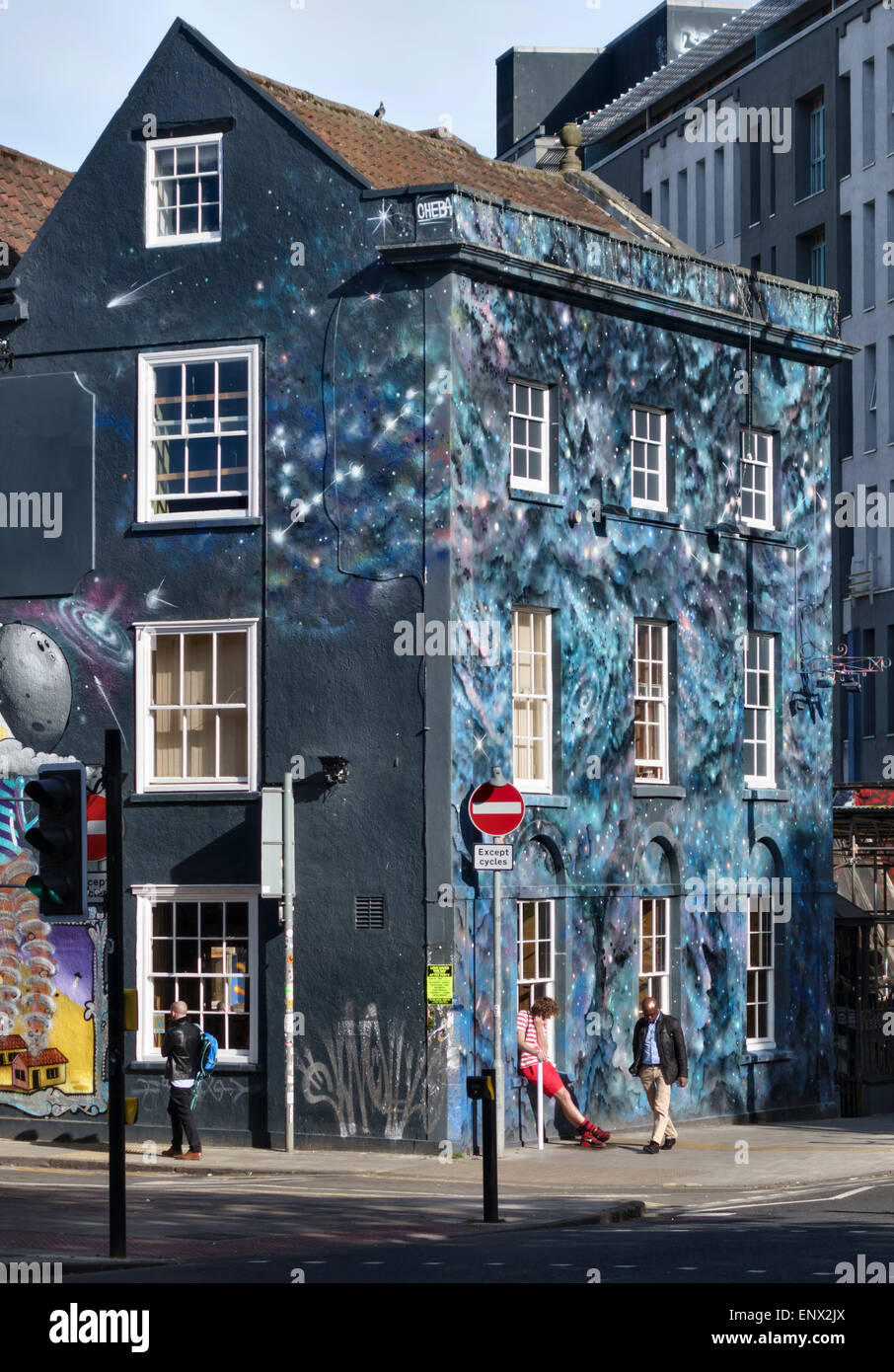 Full Moon, Stokes Croft, Bristol, UK. A backpacker's hostel painted by street artist Cheba - Stock Image