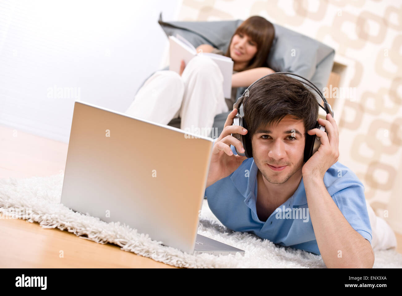 Student - Two teenager with laptop and headphones - Stock Image