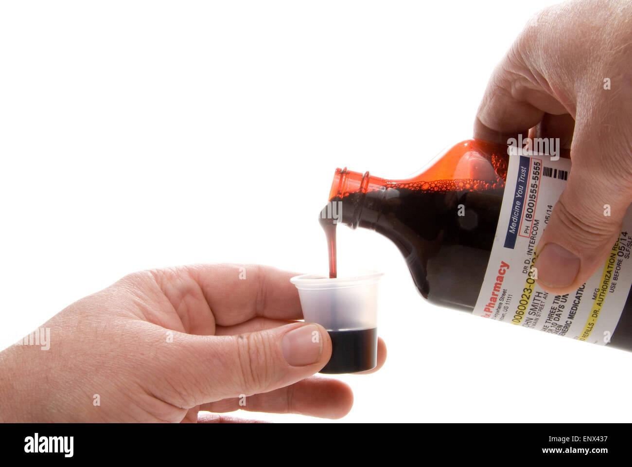 Pouring Prescription Medicine - Stock Image
