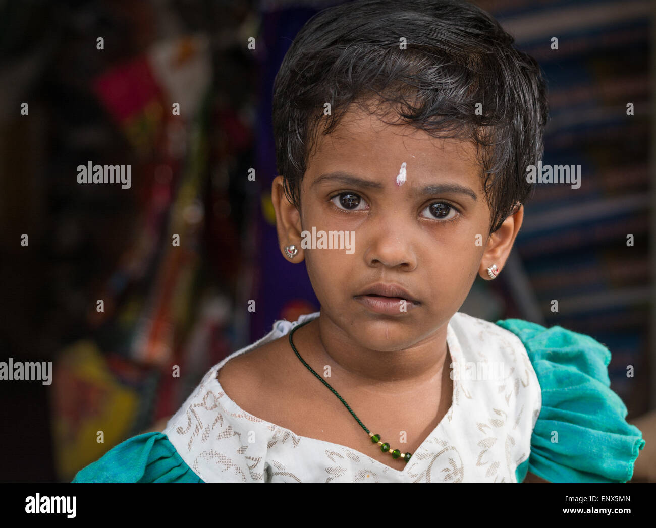 Portrait of a young Indian girl in a market in Tiruvannamalai, India - Stock Image