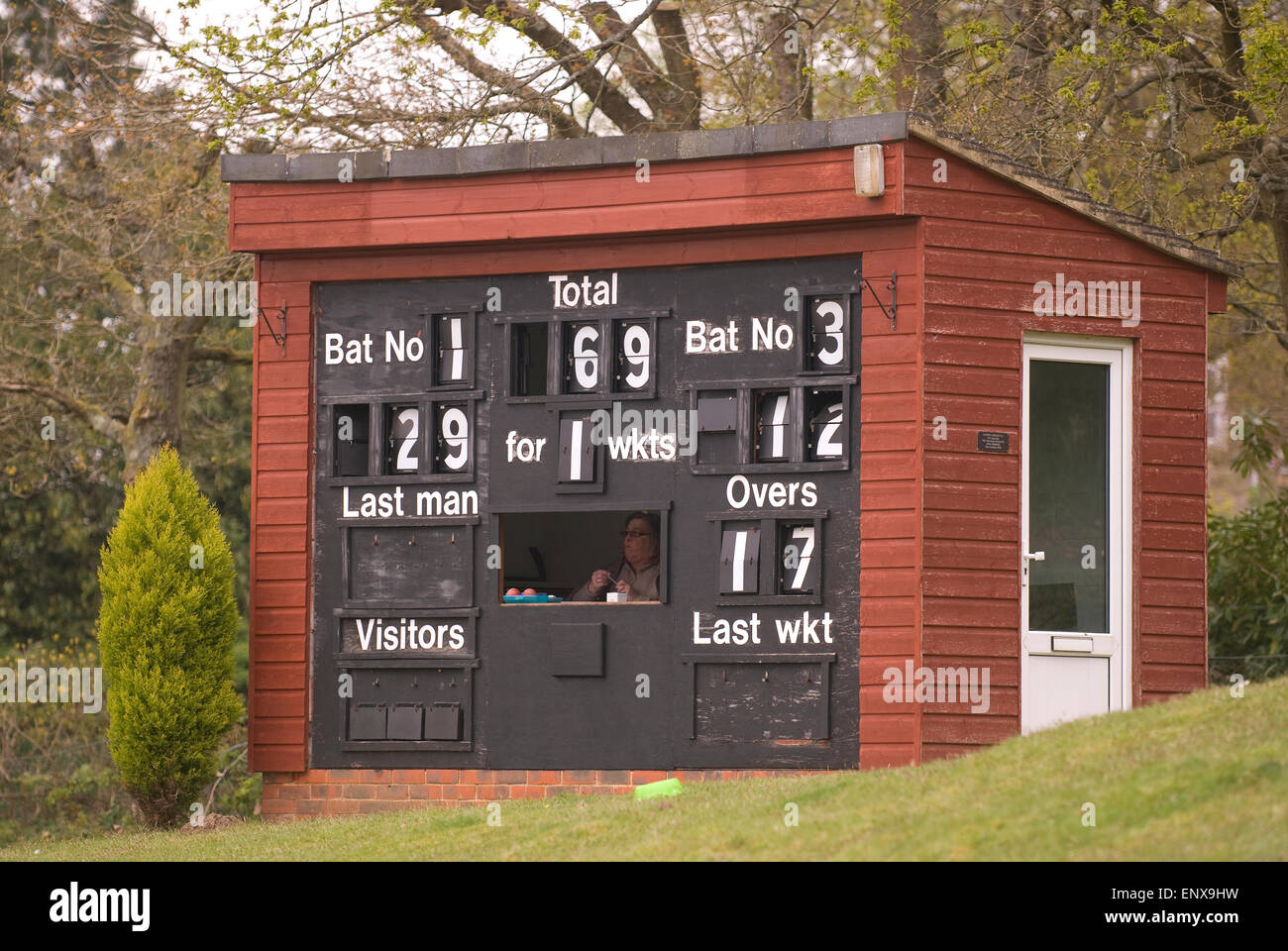 Cricket scorer and board during a local village green match, Liphook, Hampshire, UK. - Stock Image