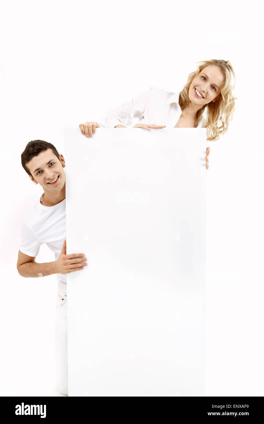 Young people with a pure board on a white background - Stock Image