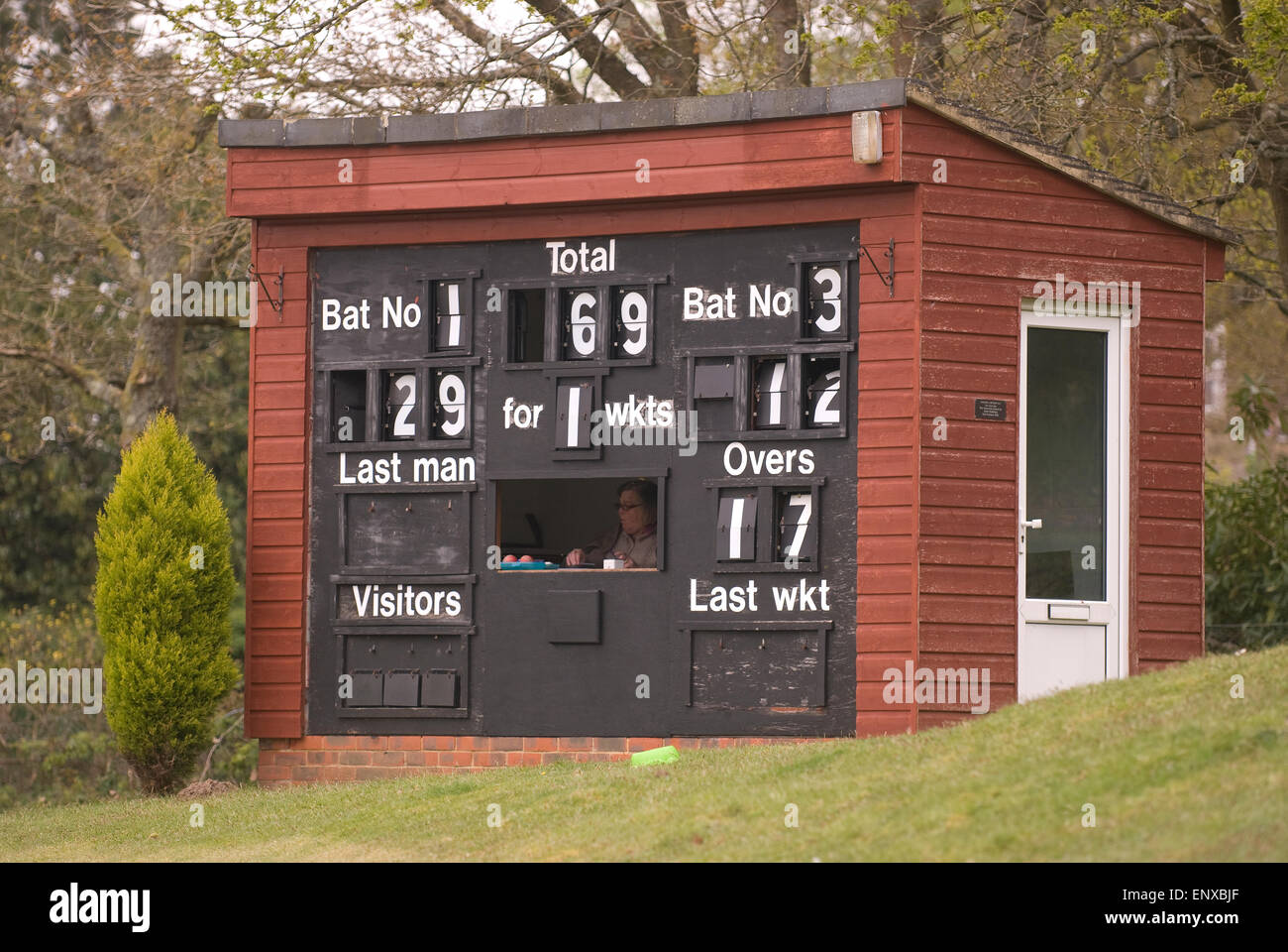 Cricket scorer and board during a local village green match, Liphook, Hampshire, UK. Stock Photo