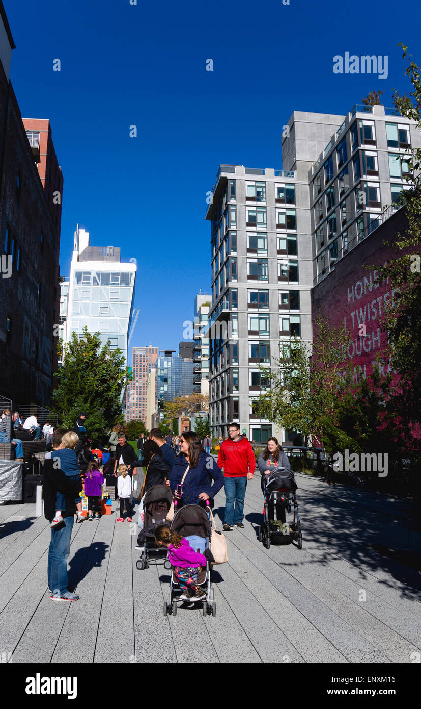 USA, New York, Manhattan, High Line linear park between buildings on a disused elevated railroad spur with people - Stock Image