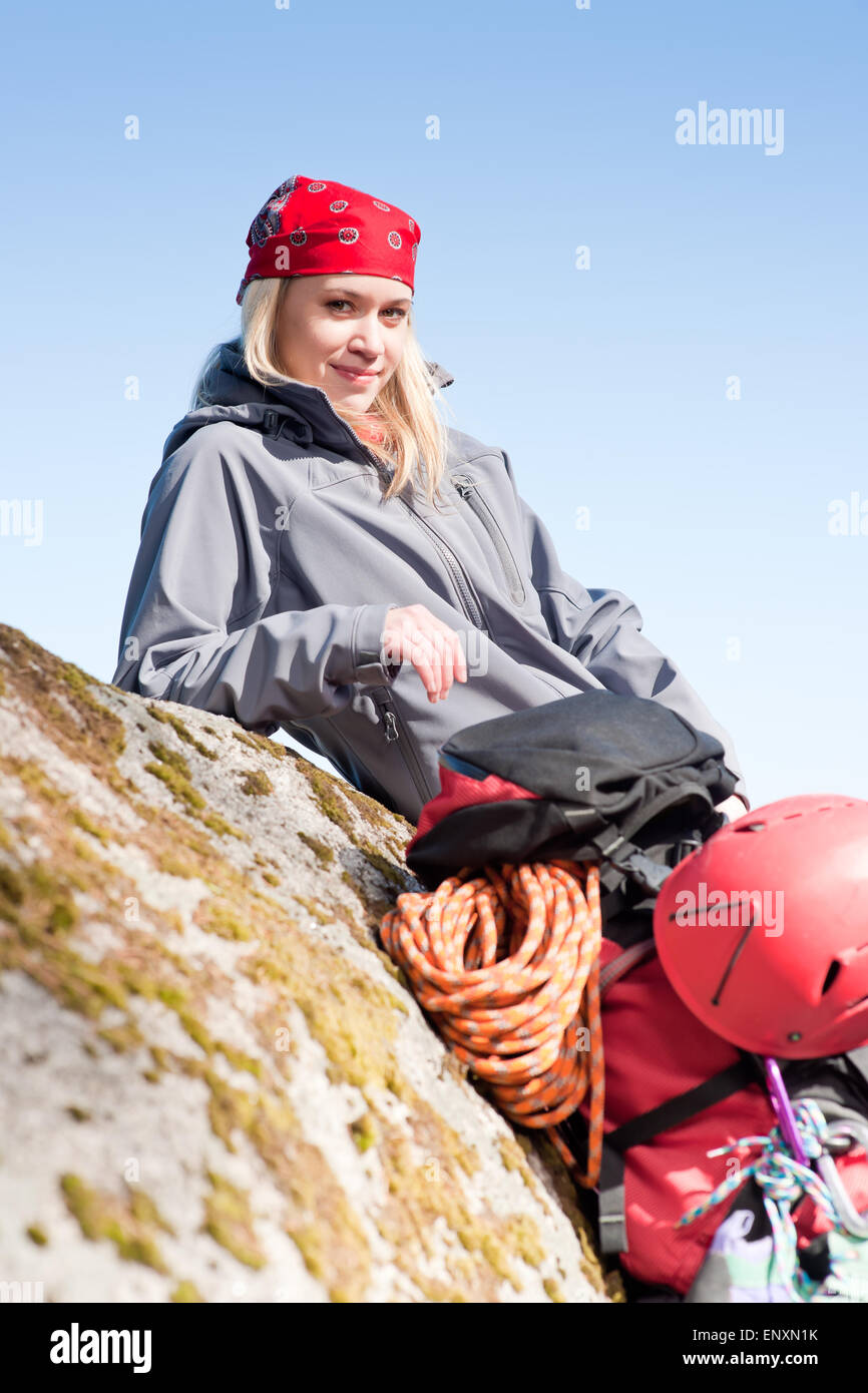 19f32a66a0c Active woman rock climbing relax with backpack Stock Photo  82336511 ...