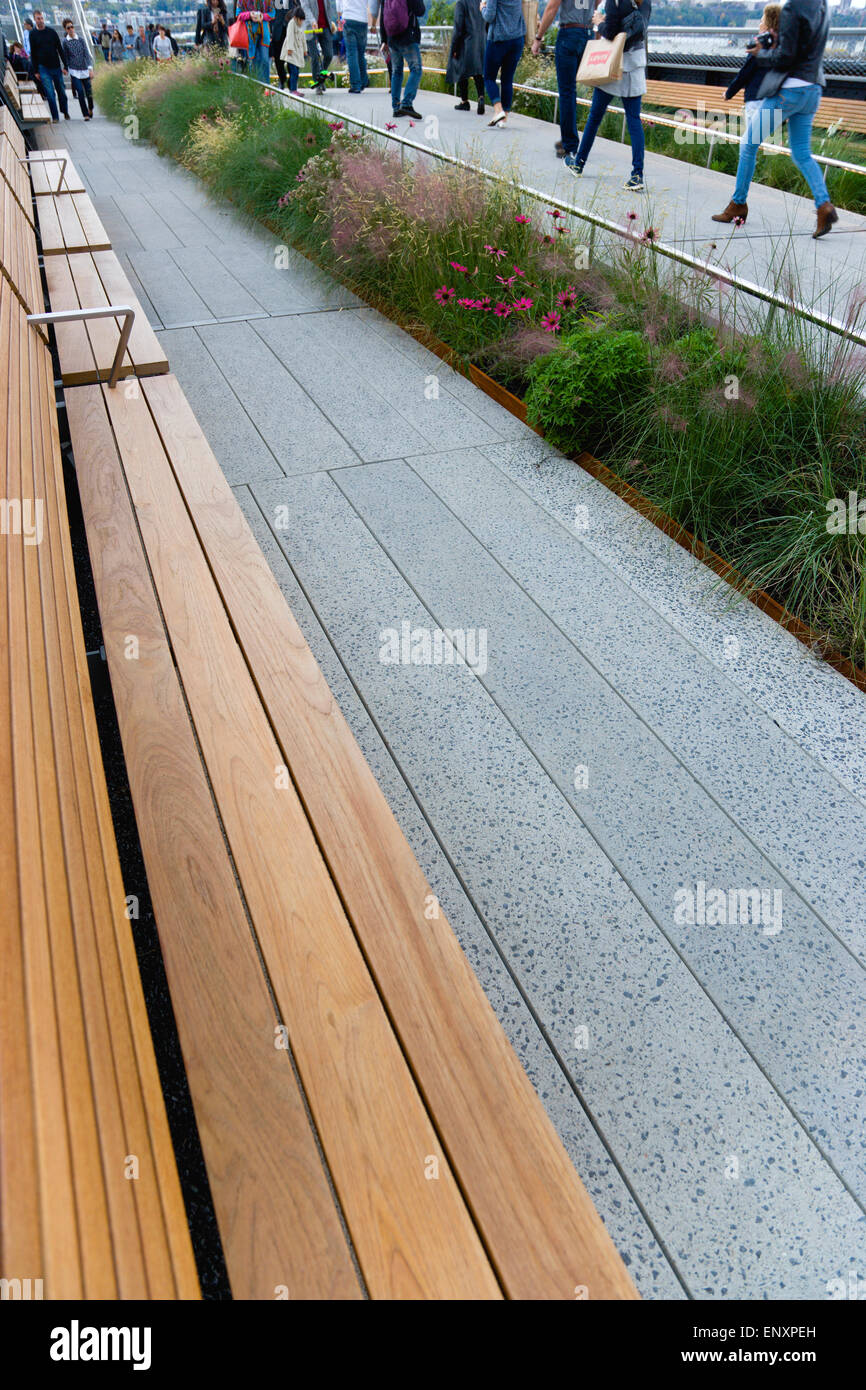 USA, New York, Manhattan, wooden benches on the High Line linear park on an elevated disused railroad spur called - Stock Image