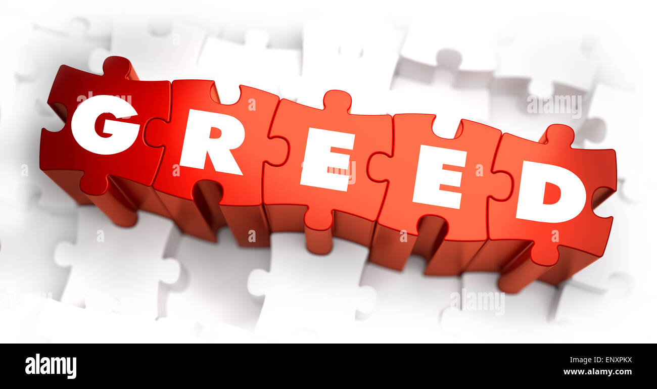 Greed - Text on Red Puzzles. Stock Photo