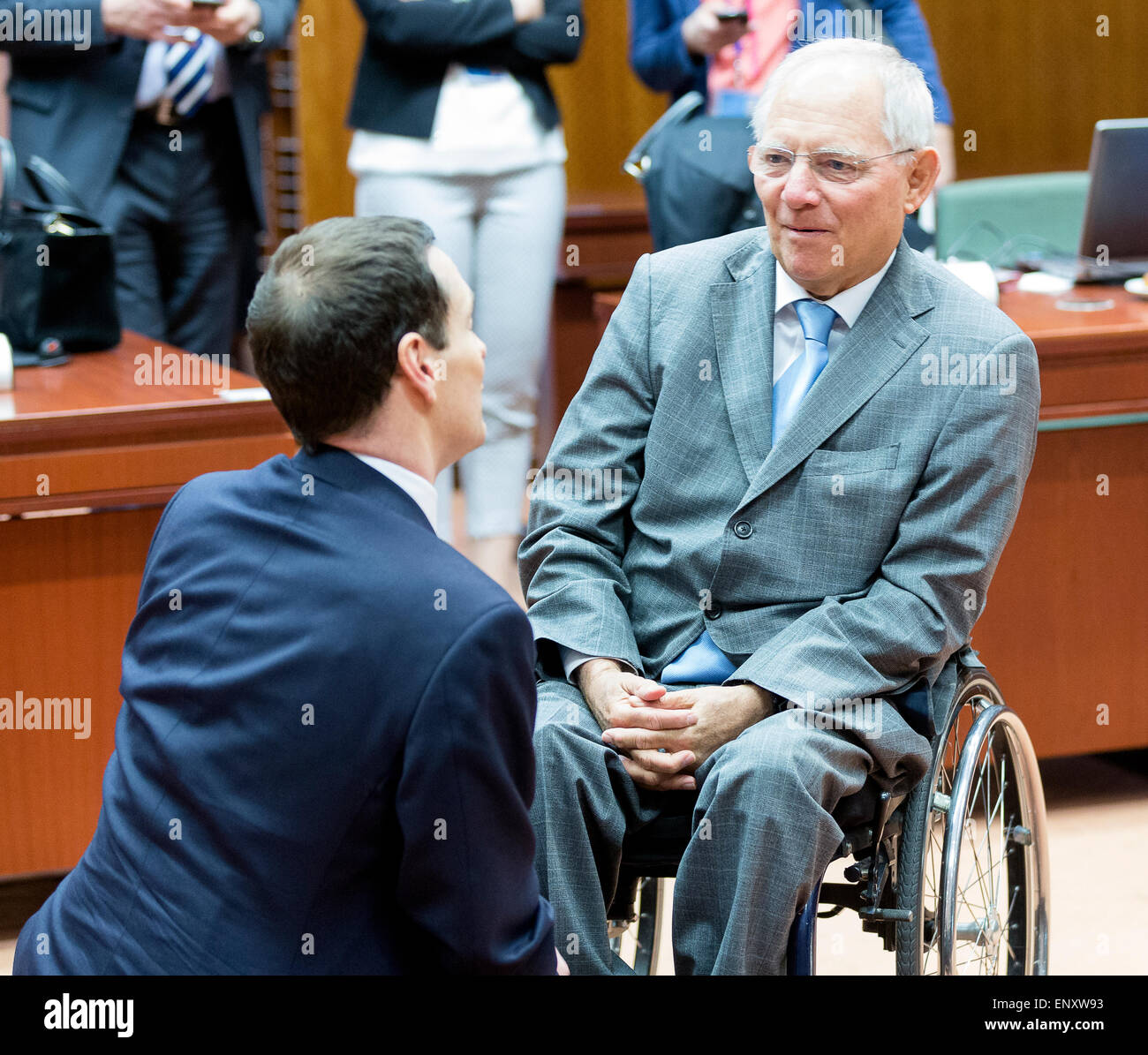 Brussels, Belgium. 12th May, 2015. British Chancellor of the Exchequer George Gideon Oliver Osborne (L) is talking - Stock Image