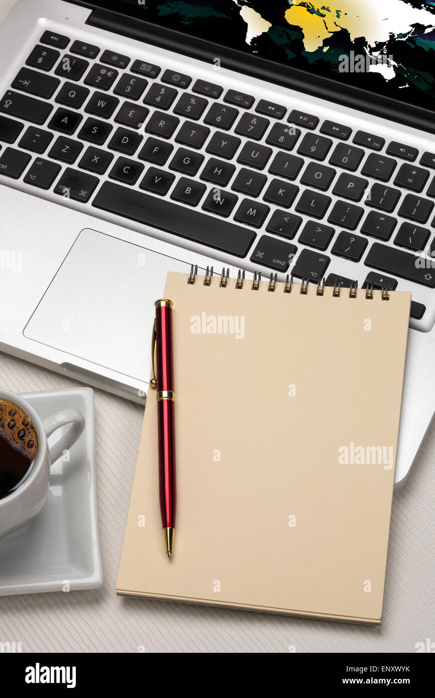 Computer laptop and a blank notepad and pen with space for text. - Stock Image