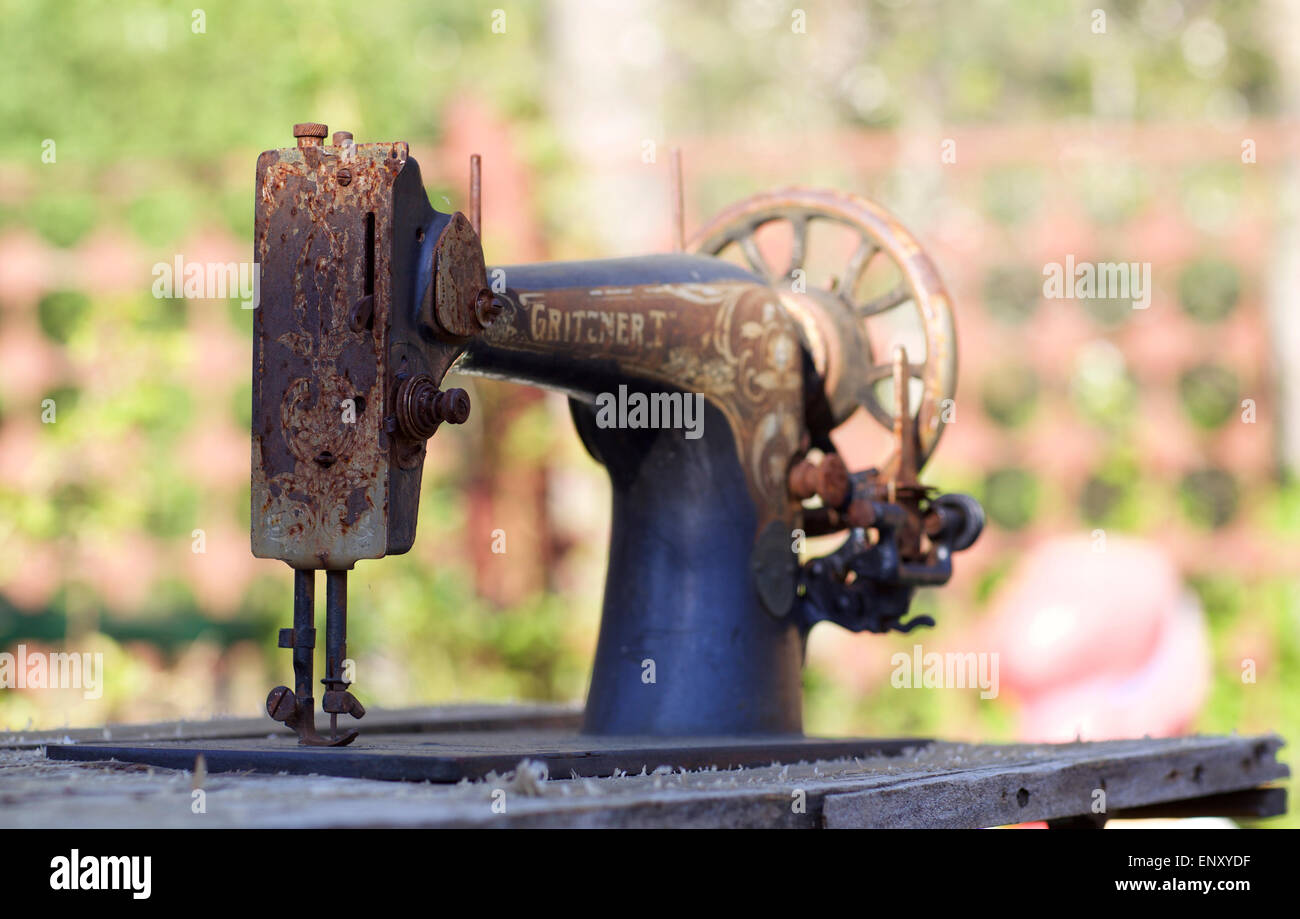old sewing machine stands on the street - Stock Image