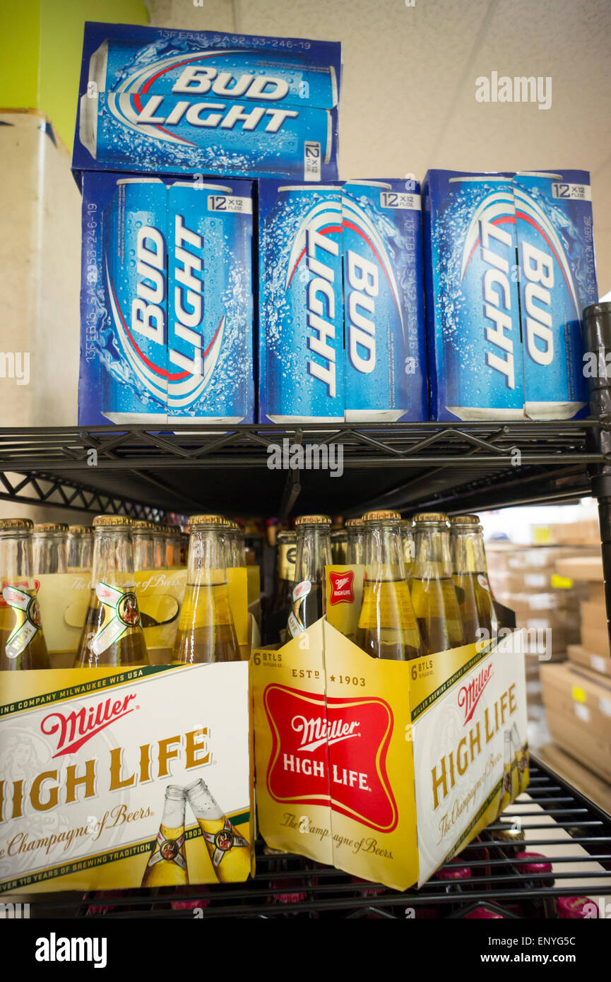 6 Packs Of Miller Beer And Cases Of Bud Light Are Seen In A Supermarket