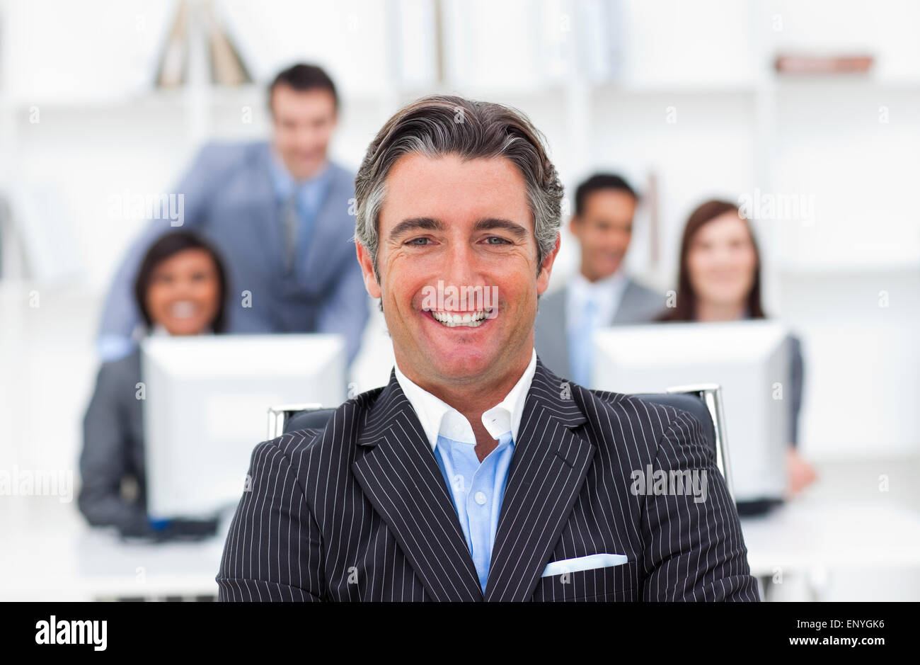 Presentation of an enthusiastic manager and his team - Stock Image