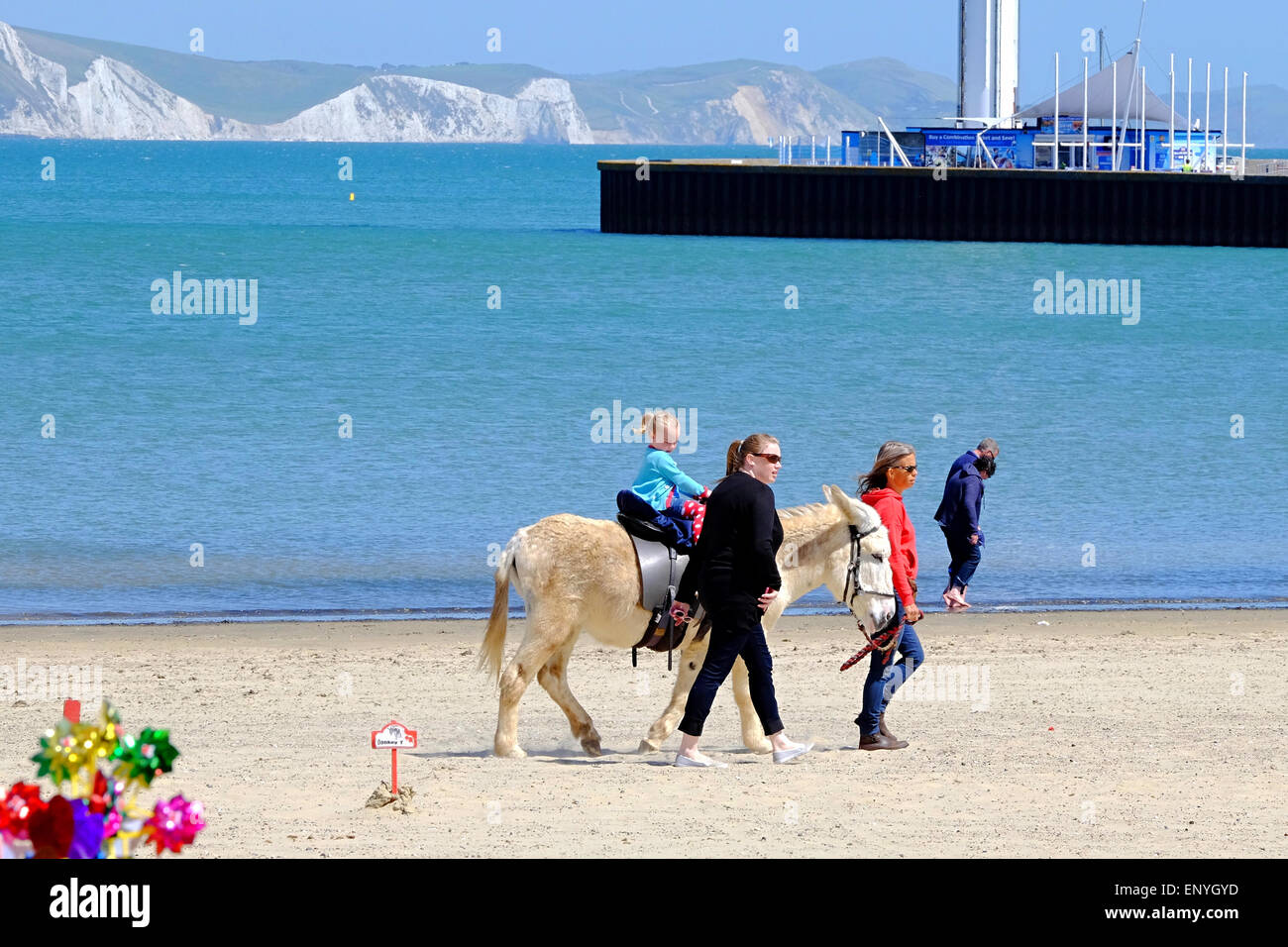 Weymouth, Dorset, UK. 12 May 2015. As the sunshine returns to the South Coast holliday makers enjoy a traditional - Stock Image
