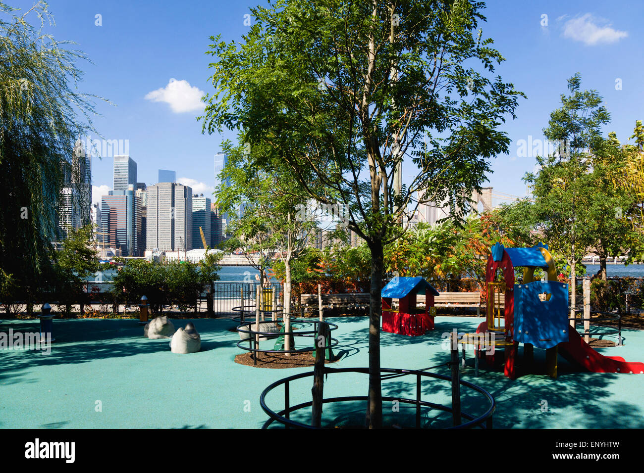 USA, New York, Brooklyn Bridge Park, deserted colourful children's playground by the Fulton Ferry Landing with - Stock Image