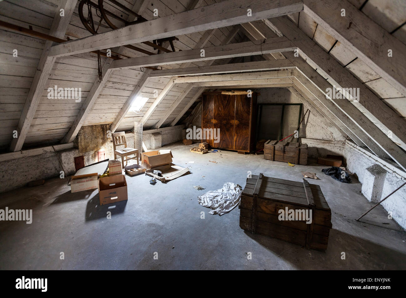 Old attic with hidden secrets of an abandoned house - Stock Image