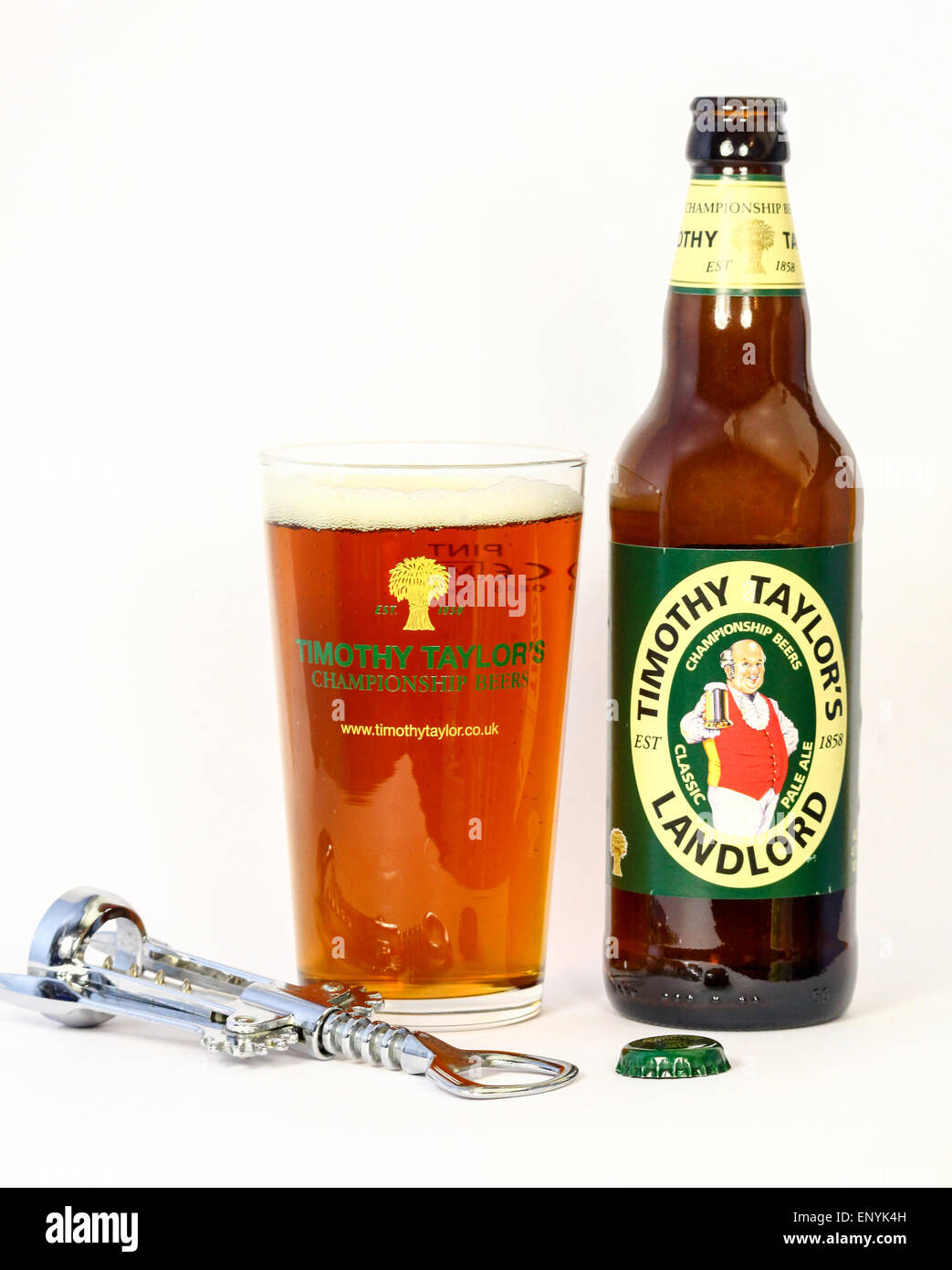 A bottle of Timothy Taylor 'Landlord' beer or ale and a full pint pot or glass with a bottle opener and - Stock Image