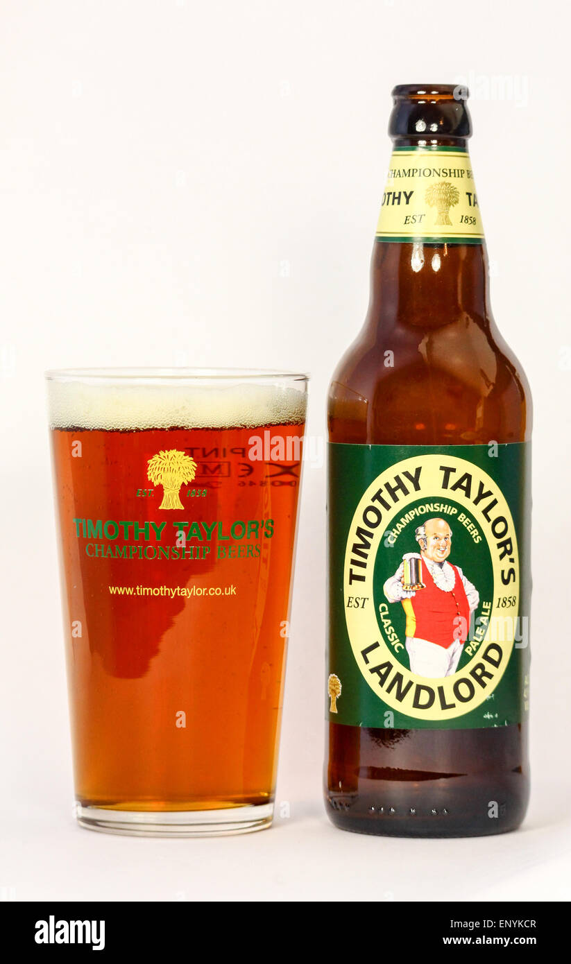 A bottle of Timothy Taylor 'Landlord' beer or ale and a full pint pot or glass - Stock Image