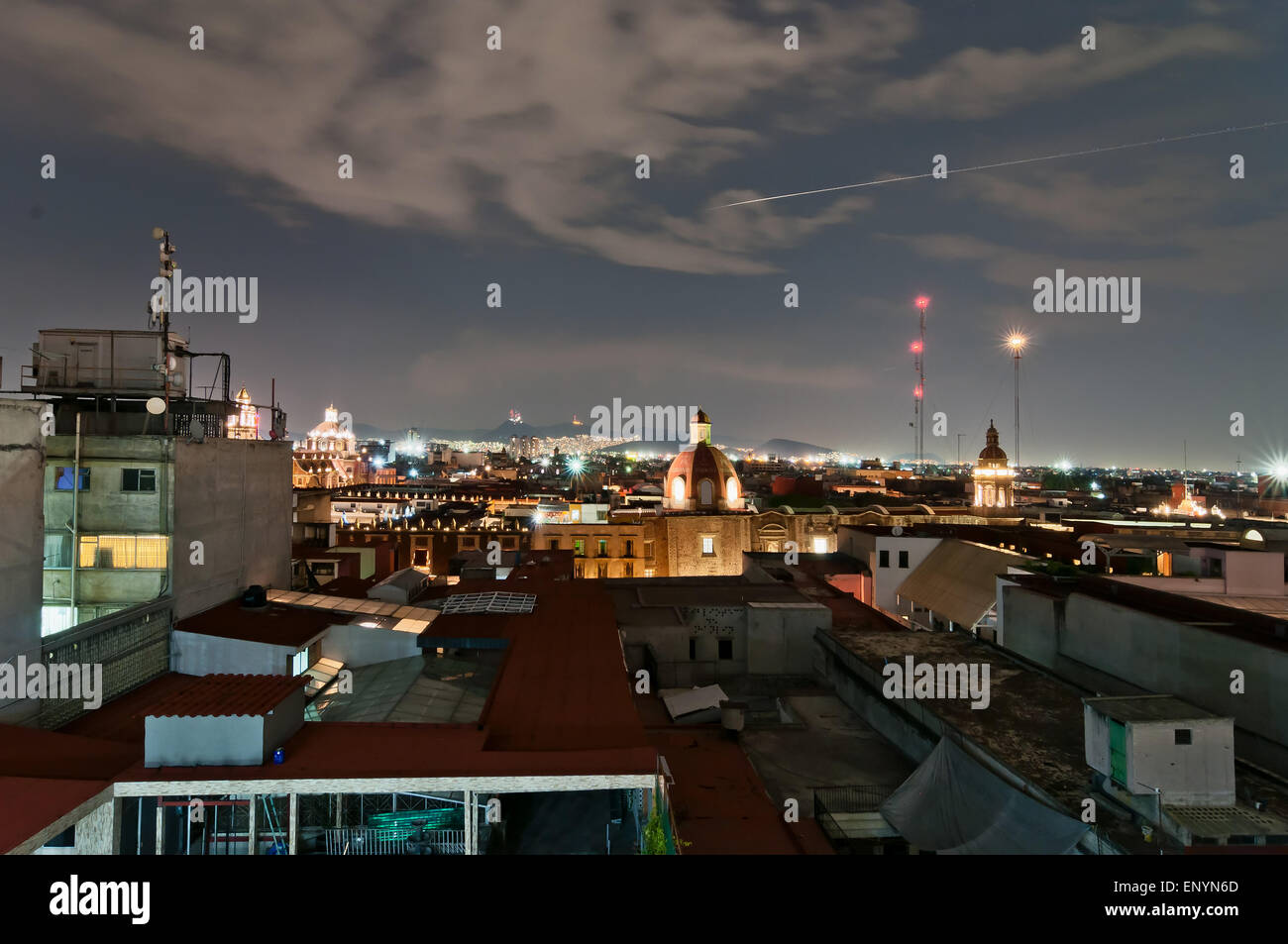Mexico City, Mexico - April 29, 2014: night view of skyline with brightly lit suburban barrios in the background - Stock Image