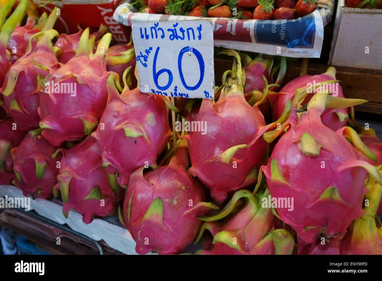 Dragon fruit, pitaya, or pitahaya on a fruit stall in a Bangkok food market, Thailand, February - Stock Image