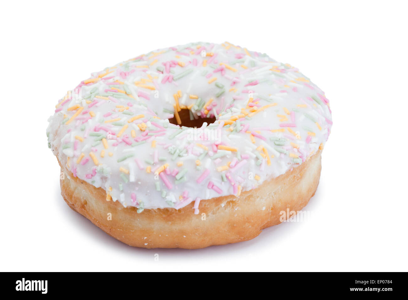 Pink Iced Doughnut covered in sprinkles isolated - Stock Image