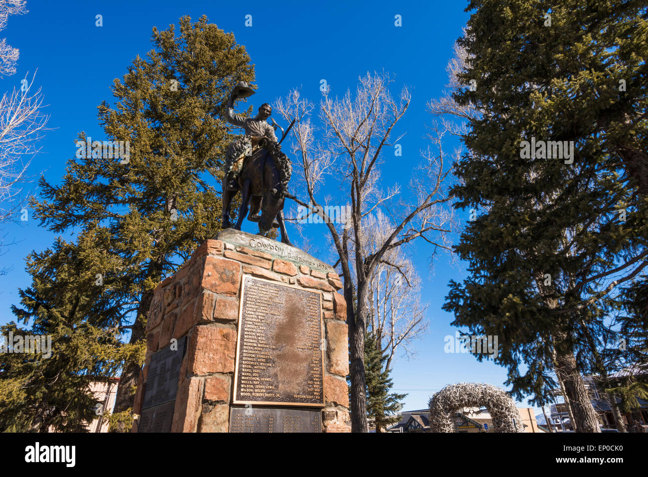 cowboy statue and war memorial in the town square jackson hole