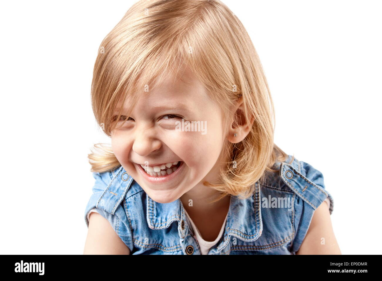 Little girl playing, laughing and having fun - Stock Image
