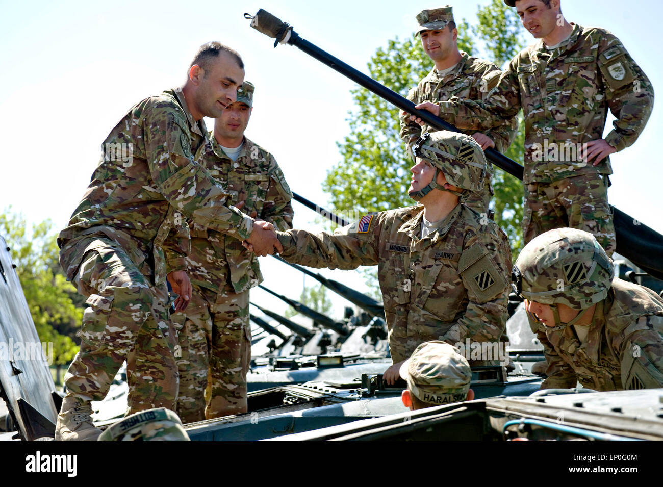 A Georgian soldier greets U.S. Army soldiers from the 3rd Infantry Division after arriving for exercise Noble Partner Stock Photo
